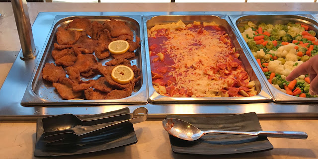 pasta, veg and breaded pork on buffet at Pirates village evening meal