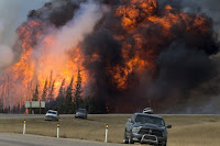 A wildfire burns near Fort McMurray, Alberta, Canada, on May 7. (Credit: Premier of Alberta/flickr) Click to Enlarge