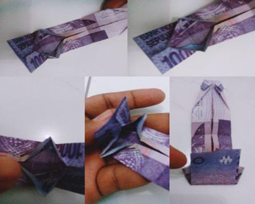 Membentuk pola origami baju pada uang kertas