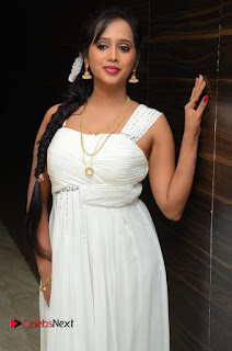 Actress Nakshatra Pictures in White Long Dress at Rojulu Marayi Movie Audio Release Function 0003