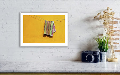 A Recently Sold Framed print of a Minimalist Photograph titled Towel Drying on a Clothesline