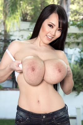 Busty Asian babe topless huge boobs