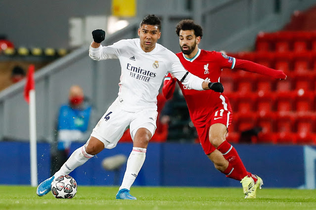 Real Madrid's Casemiro protects the ball from Liverpool's Mohammed Salah