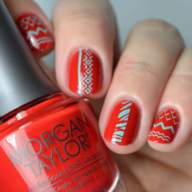 teal and red geometric nail art