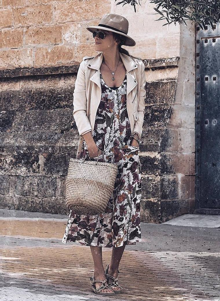 how to style a hat : biker jacket + printed dress + sandals + straw bag