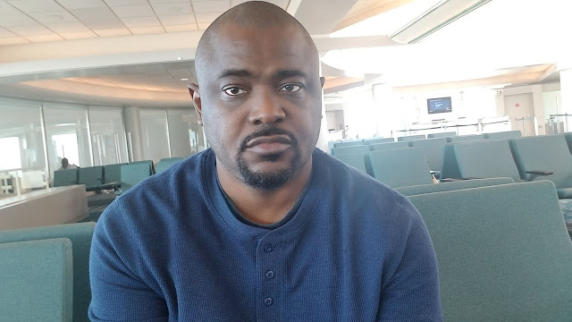 Guy at Airport with look of Disappointment about standby