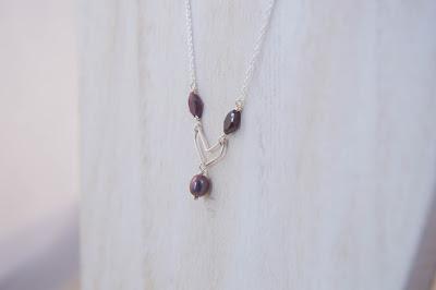 minimalist handmade chevron pendant necklace diamond garnet gemstone crystal pearl peacock red purple sterling silver soldered