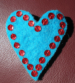 Turquoise brooch with red sequins