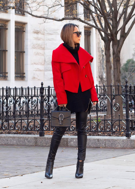 chuncky sweater layered with a high collar coat