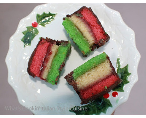 this is a triple colored cookie that looks like the rainbow in pin, green and white with chocolate melted and cut in squares