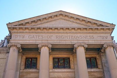 "Portico with entablature featuring Hebrew and English ""Gates of Righteousness"""