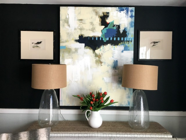 art, decorating with abstract art, lamps, black wall,