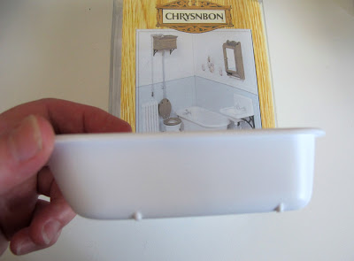 Chrysnbon dolls' house miniature bathroom furniture kit F-230, with miniature bath held up in front.