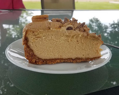 slice of peanut butter toffee on small plate on outdoor table