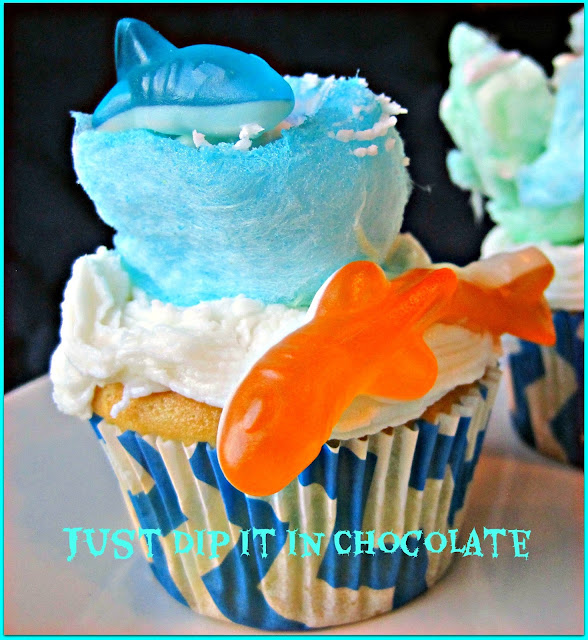 "Shark Week ""Sharknado"" Cupcakes recipe, celebrate the best B syfy movie since The Attack of the Giant Caterpilar!! These fun and delicious cupcakes are filled with berry ""Blood"" and you won't be able to resist taking a ""Bite Out of Them!"