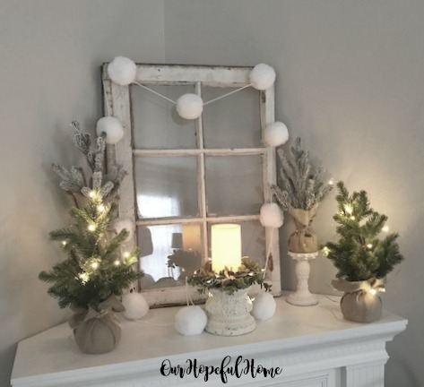 winter white mantel decor vintage window pom pom garland mini Christmas trees fairy lights