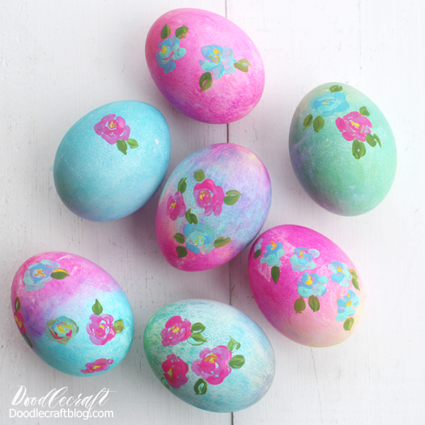 bright shades of pinks, purples, greens and blue dyed eggs with loose florals painted by hand