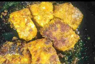 Crisp fish fry pieces on a pan or tawa