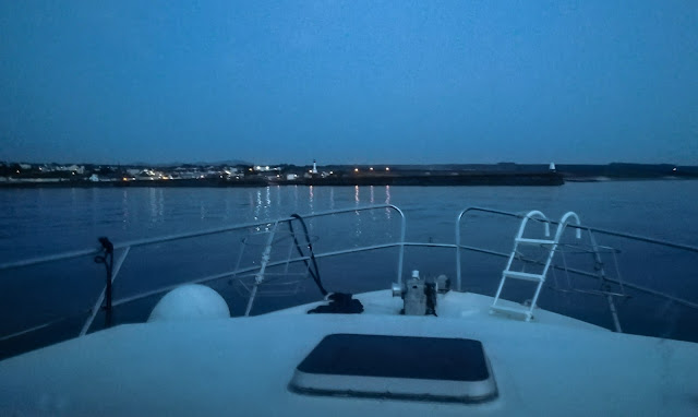 Photo of Ravensdale approaching Maryport after sunset