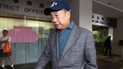 Pro-democracy Hong Kong media mogul arrested & charged