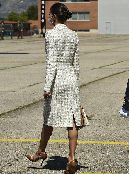 Queen Letizia wore a dress by Felipe Varela for baptism ceremony of Princess Leonor. Carolina Herrera authentic handbag