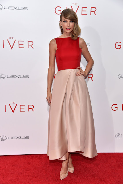 CELEBRITY STYLE TRANSFORMATION  Taylor Swift in Red and pale pink Monique Lhuillier Resort 2015 collection dress 'The Giver' premiere
