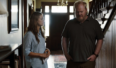 Marin Ireland and Jim Gaffigan listen for a sign that his dead wife might be a ghost in his house in a movie still for the Sundance film Light from Light (2019)