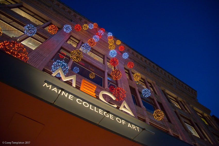Portland, Maine USA February 2017 photo by Corey Templeton. Looking up at the lights by Pandora LaCasse Design on the facade of the Maine College of Art. This color combination looks pretty sharp with the MECA logo.