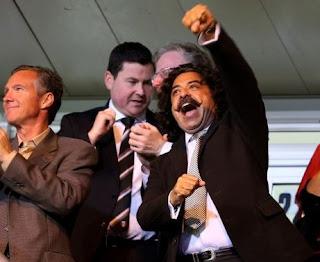 Picture of Ann Carlson Khan's hubby Khan celebrating a win