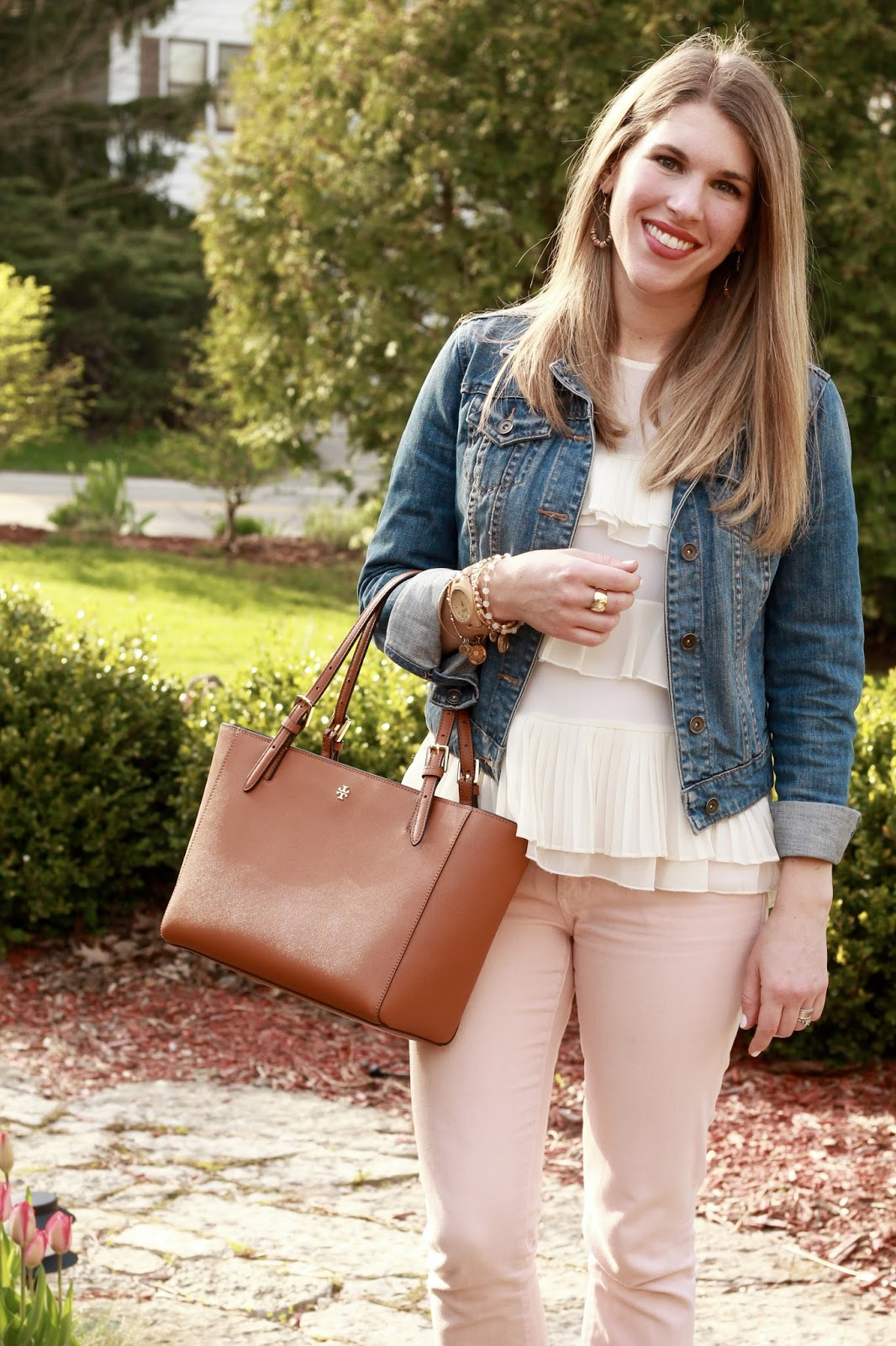 white tiered ruffle blouse, denim jacket, blush jeans, 4eursole wedge sandals, Tory Burch tote