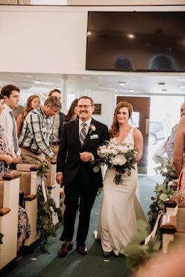father of the bride walking into ceremony