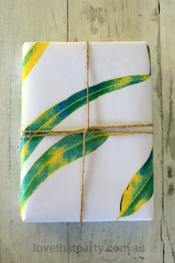 image of simple gift wrapped in rustic leaf print paper