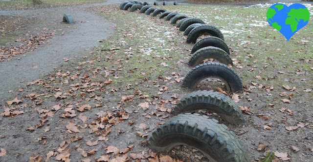 Many old car tires partly dug into the ground, so that children can hop from one tire to the next