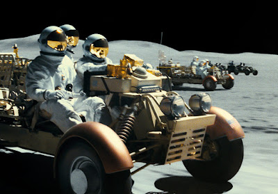 Movie still for the 2019 film Ad Astra where space pirates ambush Brad Pitt, Sean Blakemore, and Donald Sutherland on the moon
