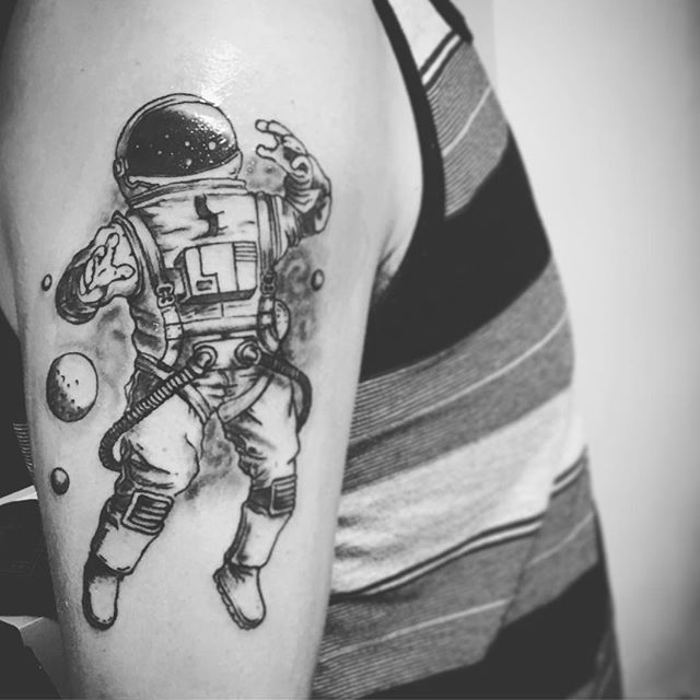astronaut black ink tattoo