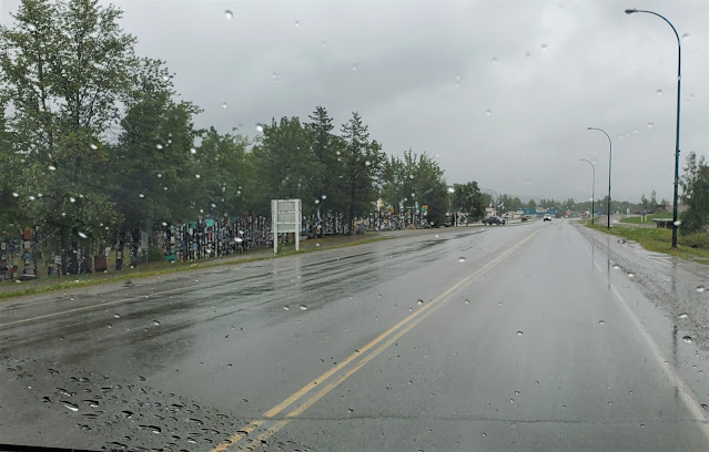 passing Watson Lake Yukon Territory on rainy day