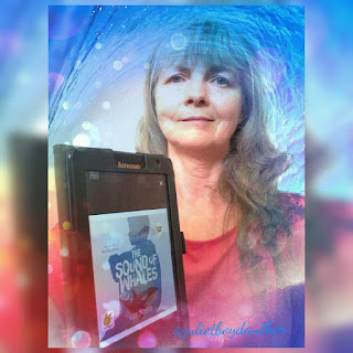 Picture of Juliet Boyd holding a copy of The Sound of Whales by Kerr Thomson