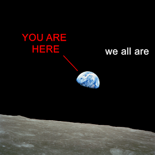 "a picture of the Earth as seen from the moon, with the words ""You are here"" and ""we all are."""