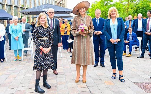 Queen Maxima wore a hera midi textured silk dress from Zeus + Dione. Gianvito Rossi suede pumps