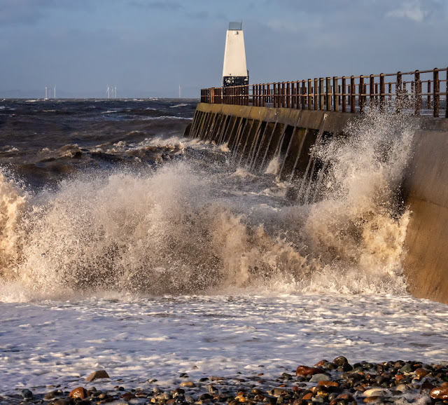 Photo of large waves battering Maryport pier during storm conditions last Friday