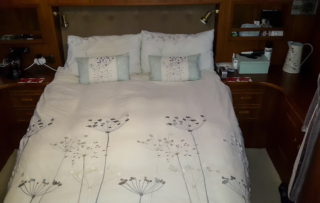 Photo of our comfy bed in which we are frequently rocked to sleep