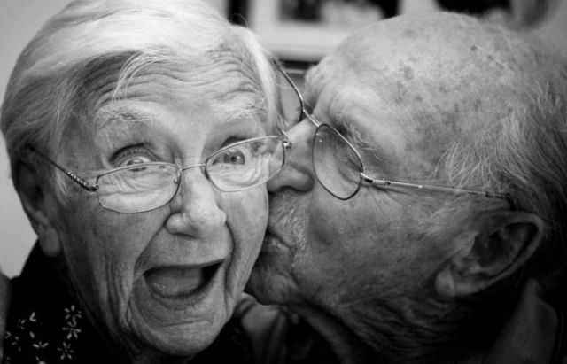 Romantic OLD Couple kiss on National Senior Citizen's Day August 21