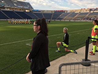 U.S. Soccer Star Megan Rapinoe Takes A Knee During National Anthem