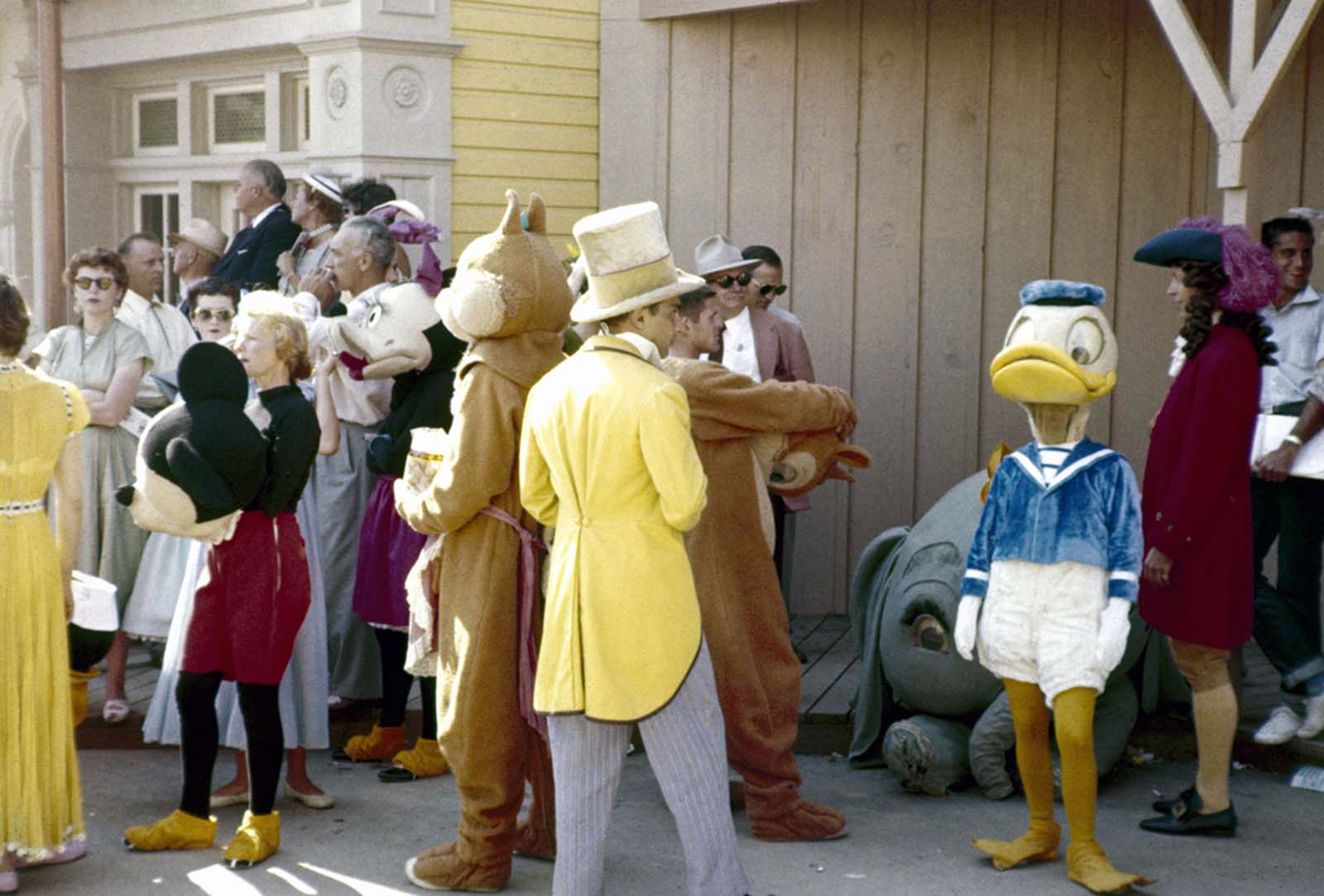 Parade participants and costumed Disney characters ready themselves for the televised grand opening of Disneyland on July 17, 1955.