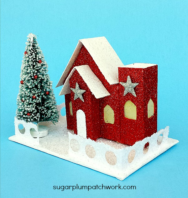 Red glitter house embellished wiht silver stars