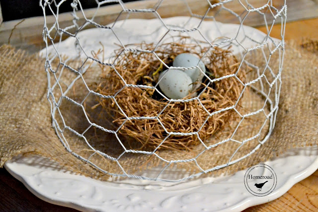 Nest with eggs on burlap covered with chicken wire