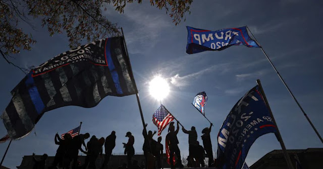 Donald Trump's supporters take to the streets of Washington demanding 'four more years'