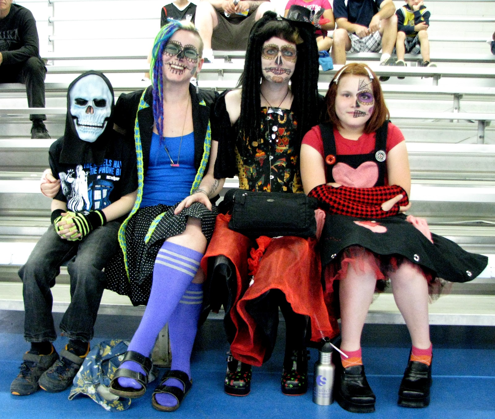 i had barely found a seat when i saw this group who had obviously been inspired by the mexican day of the dead i love to see people at roller derby who