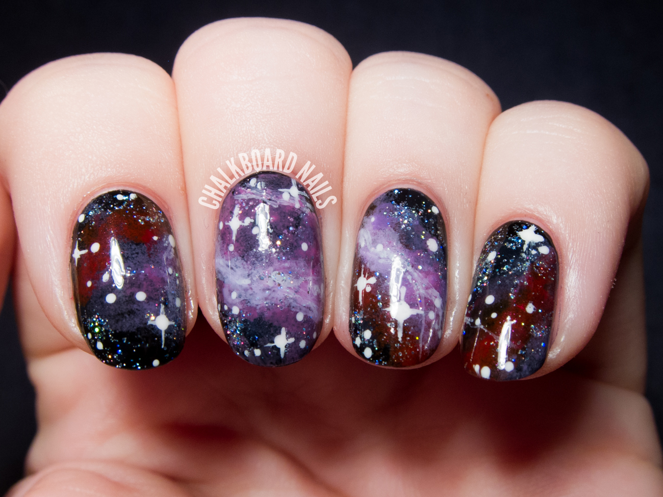 Purple galaxy nail art by @chalkboardnails