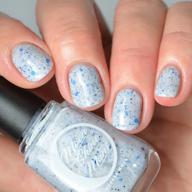 grey crelly nail polish with blue glitter swatch
